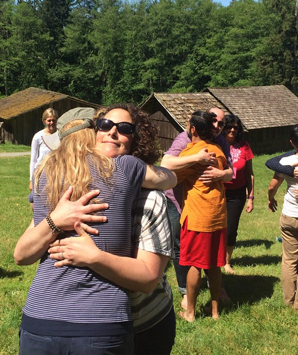 Hugging at diversity retreat